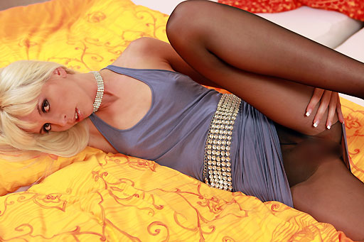 Alexa Wild in bed with black pantyhose