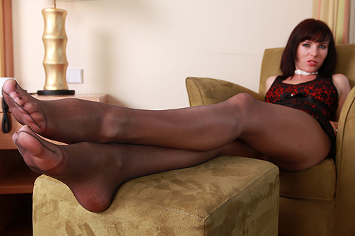 Nadja reading a magazine in pantyhose