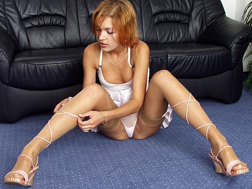 Anastasia in tan stockings